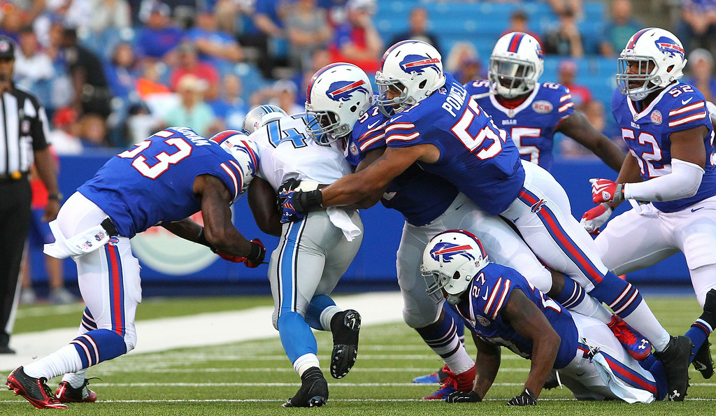 . Detroit Lions running back Theo Riddick (41) is brought down by a host of Buffalo Bills players during the first half of a preseason NFL football game, Thursday, Aug. 28, 2014, in Orchard Park, N.Y. (AP Photo/Bill Wippert)