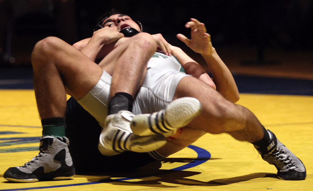 . De La Salle\'s Nathan Cervantes, top, struggles  against Freedom\'s Ricky Coster in the 120-pound finals at the North Coast Section wrestling championships held at Newark Memorial High School in Newark, Calif., on Saturday, Feb. 23, 2013. Coster would get the win. (Anda Chu/Staff)
