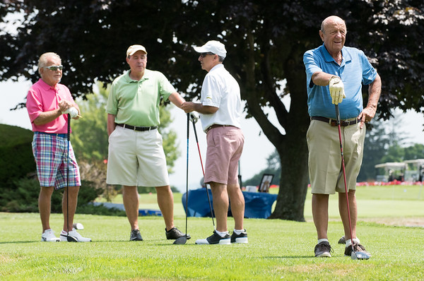 07/16/18 Wesley Bunnell | Staff The 2018 Mayor's Cup Golf Outing took place on Monday morning at Chippanee Country Club benefitting the Boys and Girls Club of Bristol. Don Schmidt, Bill Stevens and Marc Blum stand on the tee as Eric Labadia watches the foursome ahead of them.