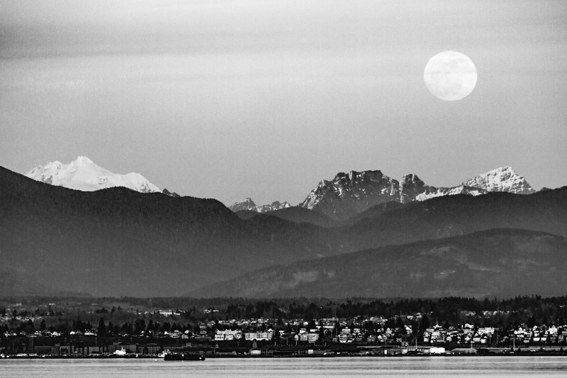 Full moon rising over the Cascade Mountains and Everett, Washington and Puget Sound