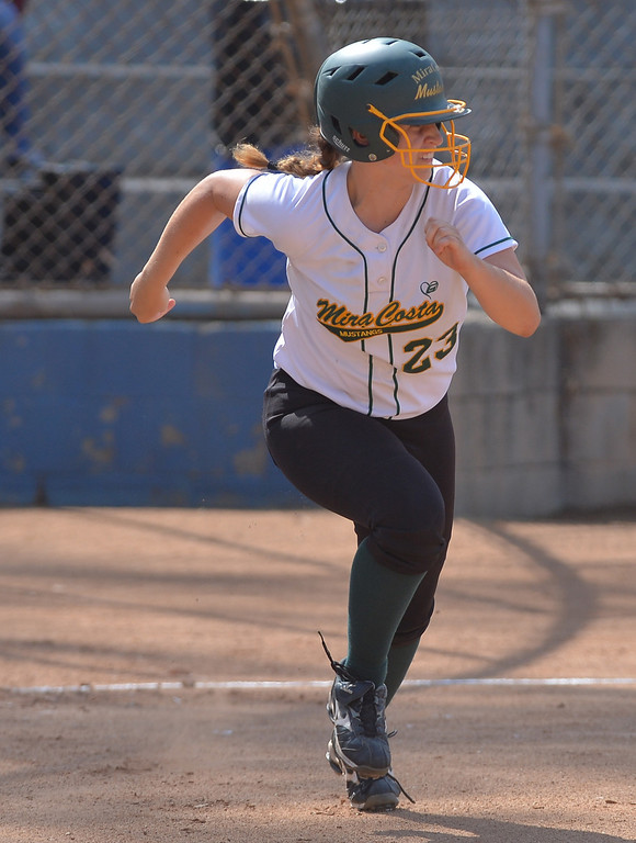 . 0517_SPT_TDB-L-MC-TORRANCE--- Torrance, CA--5/16/13--- Staff Photo: Robert Casillas  - Daily Breeze / LANG--- Mira Costa defeated Torrance High 7-1 in CIF DIV III softball playoff game at Wilson Park in Torrance. Ali Timmons runs to first.