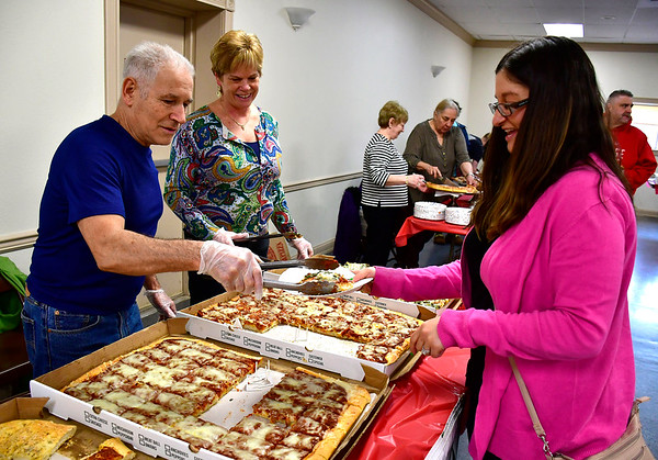 3/14/2019 Mike Orazzi | Staff Sal Mangiafico serves pizza to Beth Neumann as Nancy Kaczynski looks on during the Plainville Chamber of Commerce 2019 Pizza Feud at the Veterans of Foreign Wars in Plainville Thursday evening.