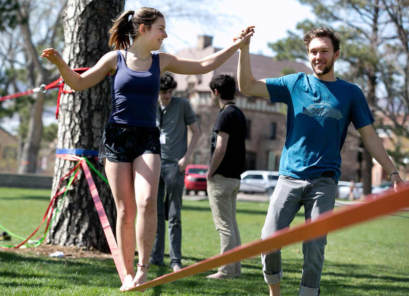 Abby Williams '20 gets help from Noah Brodsky '17 while trying out a slackline on the quad April 13, 2017.