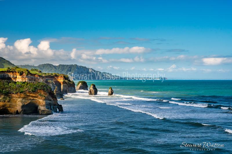 The stunning Taranaki coastline at Tongaporutu with Mt Taranaki in the distance