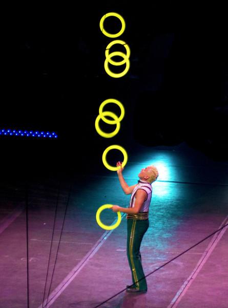 jugglingmanyfluorescentdiscs.jpg