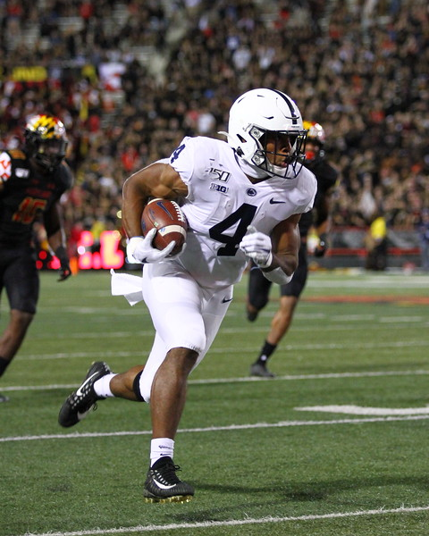 Penn State RB #4 Journey Brown rushes with the ball.