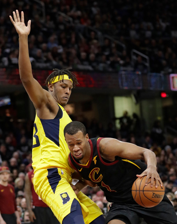 . Cleveland Cavaliers\' Rodney Hood (1) drives past Indiana Pacers\' Myles Turner (33) in the first half of Game 7 of an NBA basketball first-round playoff series, Sunday, April 29, 2018, in Cleveland. The Cavaliers won 105-101. (AP Photo/Tony Dejak)