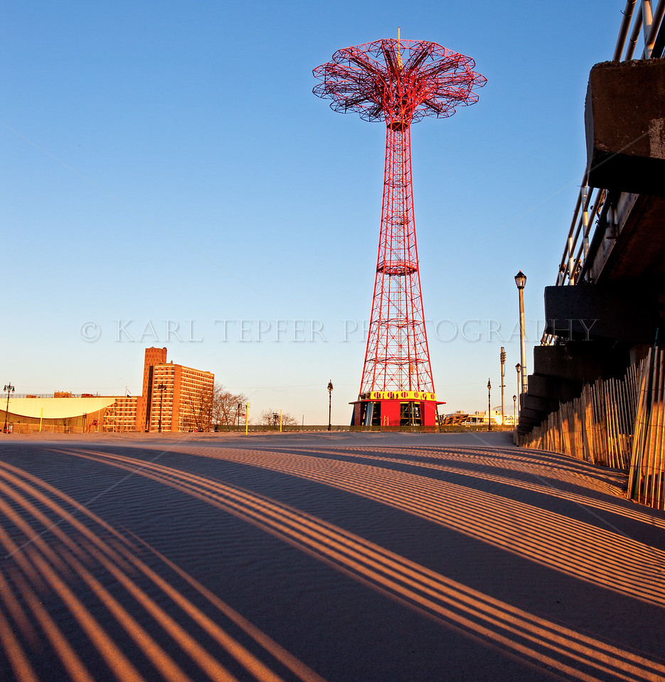 Coney Island Parachute Jump at Dawn<br /> Shadows in the sand created by the rising sun<br /> Taken a few weeks after Hurricane Sandy.....2012