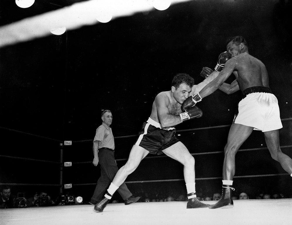 . Middleweight champion Jake LaMotta, left, and challenger Sugar Ray Robinson exchange punches in first round of the world middleweight title bout at Chicago Stadium, Ill., Feb. 14, 1951.  (AP Photo)