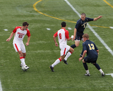 POUGHKEEPSIE, NY - SEPTEMBER 26: Marist Mens Soccer verses La Salle at Marist College on September 26, 2010 in Poughkeepsie New York.  Marist's #33 James Curley and #9 Stephan Brossard split La Salle defenders to move ball downfield.   Photo by Sandy Tambone