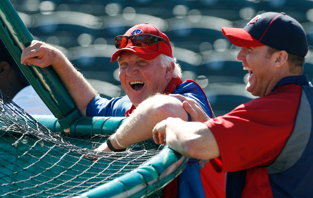 . Minnesota Twins designated hitter Jim Thome, right, jokes with Philadelphia Phillies manager Charlie Manuel, for whom Thome played with the Cleveland Indians and the Phillies, prior to a spring training baseball game in Fort Myers, Fla., Sunday, March 13, 2011. (AP Photo/Charles Krupa)