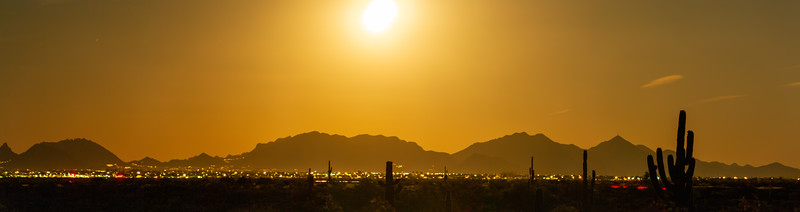 Long exposure panorama of the full moon rising on the desert and city of Phoenix