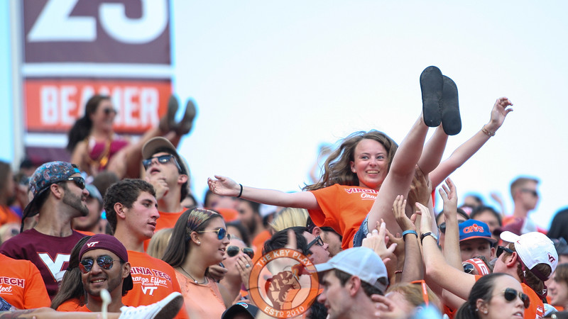 A Virginia Tech fan is lifted into the air in the North endzone stands for each Virginia Tech point scored so far. (Mark Umansky/TheKeyPlay.com)