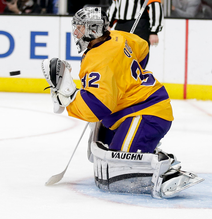 . Los Angeles Kings goalie Jonathan Quick makes a save against the Detroit Red Wings during the third period of an NHL hockey game in Los Angeles, Tuesday, Feb. 24, 2015. The Kings won 1-0. (AP Photo/Chris Carlson)