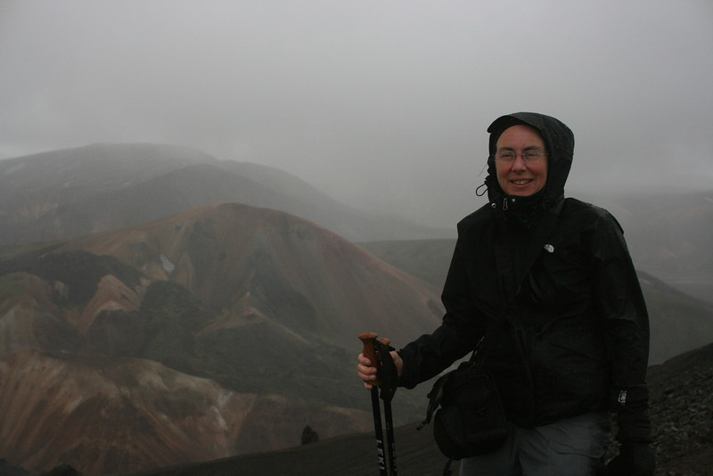 Red cheeks indicate cold while day hiking near Landmannalaugar. Note winter gloves.