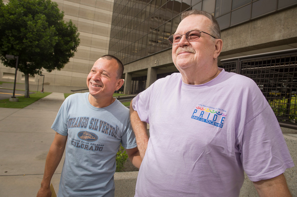 . Tony Almeida, left, and Long Beach Pride co-founder Bob Crow, both of Long Beach, receive their marriage license at the Los Angeles County Registrar-Recorder/County Clerk office in Norwalk, Ca. July 1, 2013.   (SGVN staff photo by Leo Jarzomb)