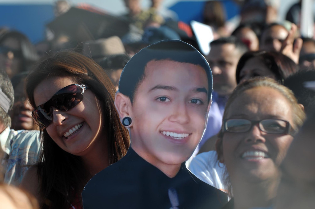 . Deborah Villareal, left, is the proud mom of senior Richard Diaz, pictured in a cut-out next to her. The 2013 North High School commencement ceremonies take place on the school\'s football field in Torrance Wednesday afternoon.