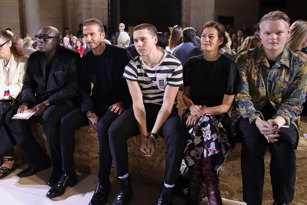 . David Beckham, second from left, and Brooklyn Beckham, third from right, sit in the front row during the Victoria Beckham Spring/Summer 2018 fashion show during New York Fashion Week, Sunday, Sept. 10, 2017. (AP Photo/Mary Altaffer)