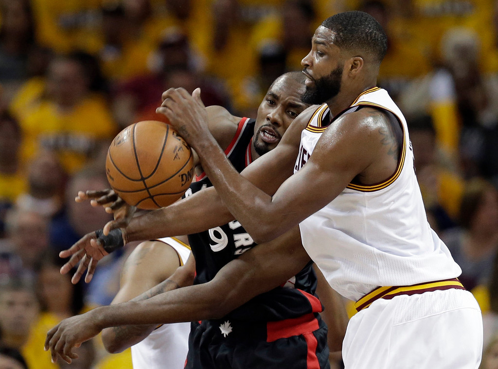 . Toronto Raptors\' Serge Ibaka, from Congo, and Cleveland Cavaliers\' Tristan Thompson, right, battle for the ball in the first half in Game 1 of a second-round NBA basketball playoff series, Monday, May 1, 2017, in Cleveland. The Cavaliers won 116-105. (AP Photo/Tony Dejak)