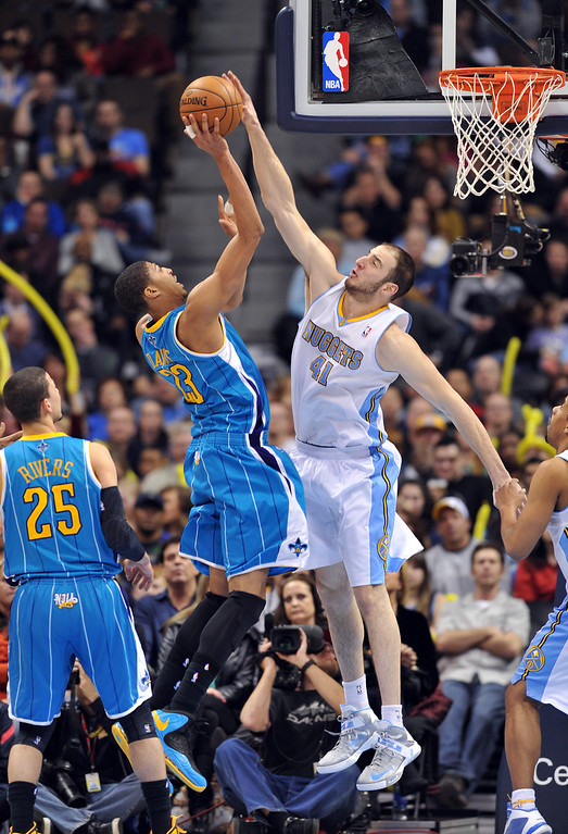 . Kosta Koufos of Denver Nuggets #41 blocks the shot of Anthony Davis of New Orleans Hornets #23 on February 1, 2013,  at the Pepsi Center in Denver.  (Photo By Hyoung Chang/The Denver Post)