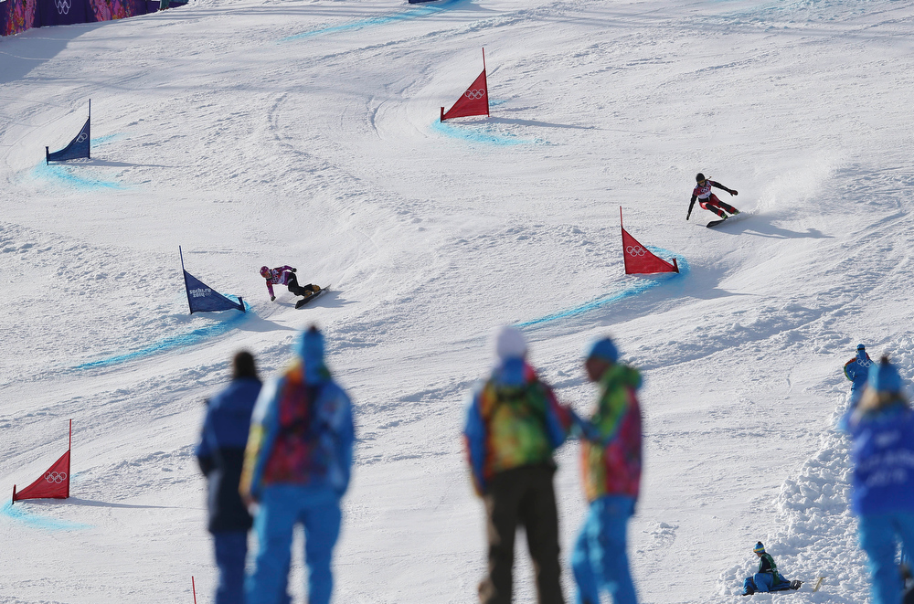 . Switzerland\'s Patrizia Kummer, right, competes with Japan\'s Tomoka Takeuchi in the women\'s snowboard parallel giant slalom final at the Rosa Khutor Extreme Park, at the 2014 Winter Olympics, Wednesday, Feb. 19, 2014, in Krasnaya Polyana, Russia. Kummer took the gold medal.  (AP Photo/Sergei Grits)