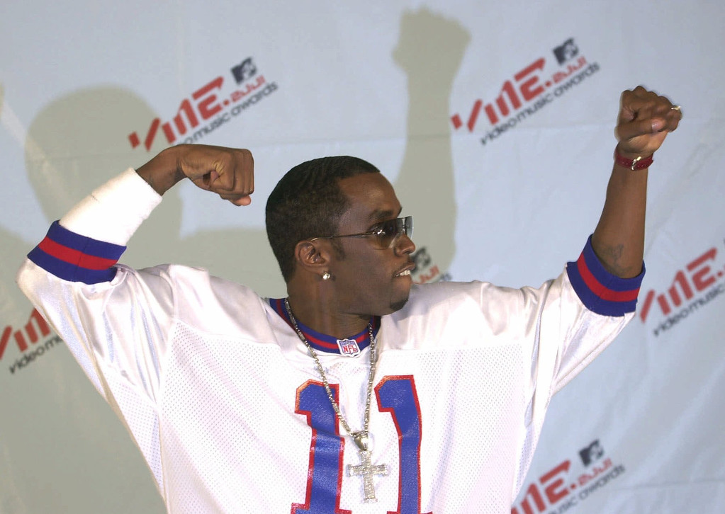 . Puffy Daddy poses for photographers at the MTV Video Music Awards in New York at the Metropolitan Opera House Thursday Sept. 6, 2001. (AP Photo/Suzanne Plunkett)