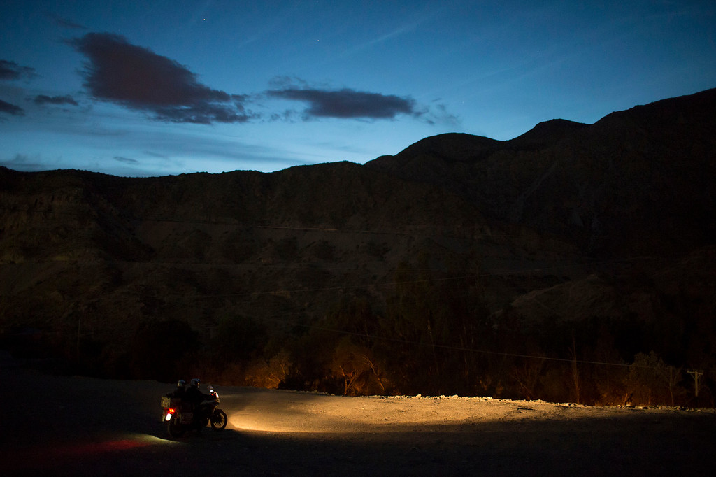. A motorcycle leaves the Dakar camp ahead of the third stage of the Dakar Rally 2015 between the cities of San Juan and Chilecito, Argentina, Tuesday, Jan. 6, 2015. The race will finish on Jan. 17, passing through Bolivia and Chile and returning to Argentina. (AP Photo/Felipe Dana)