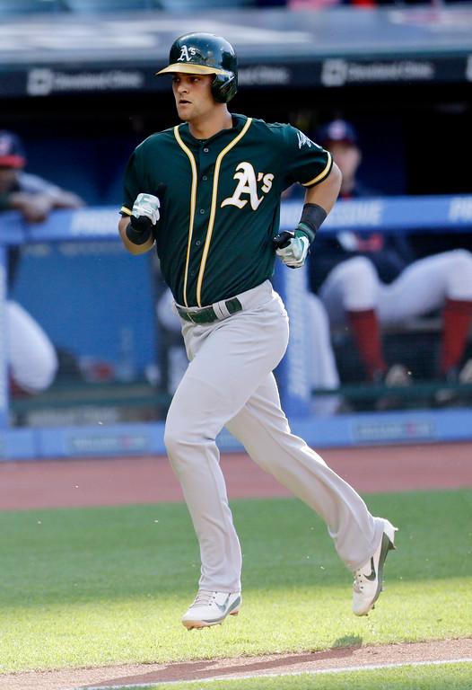 . Oakland Athletics\' Chad Pinder runs the bases after hitting a solo home run off Cleveland Indians starting pitcher Mike Clevinger in the third inning of a baseball game, Wednesday, May 31, 2017, in Cleveland. (AP Photo/Tony Dejak)
