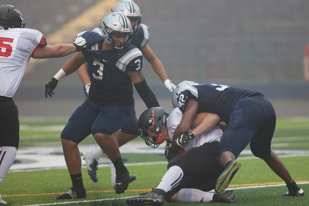 . Jen Forbus - The Morning Journal<br> Lorain linebacker Savon Chavis takes down St. Joseph North\'s Keegan Bertrand on Sept. 14.