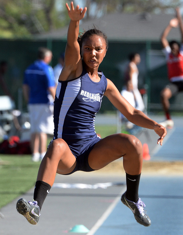. Redlands\' Margaux Jones competes in the long jump during the CIF-SS Masters Track and Field meet at Falcon Field on the campus of Cerritos College in Norwalk, Calif., on Friday, May 30, 2014.   (Keith Birmingham/Pasadena Star-News)