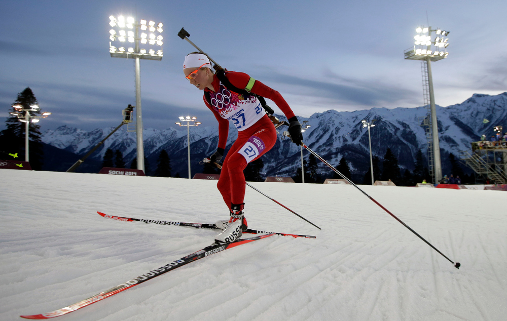 . Switzerland\'s Selina Gasparin competes on her way to win the silver medal in the women\'s biathlon 15k individual race, at the 2014 Winter Olympics, Friday, Feb. 14, 2014, in Krasnaya Polyana, Russia. (AP Photo/Felipe Dana)