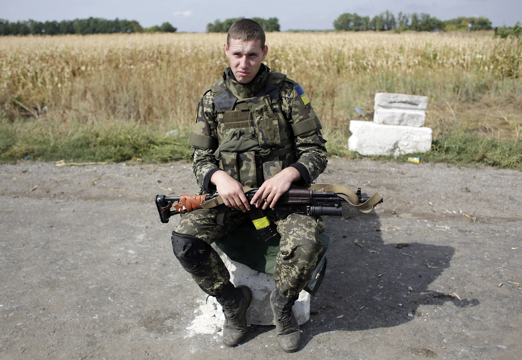 . A Ukrainian soldier sits as he guards at a checkpoint controlled by Ukrainian forces on September 10, 2014, near the small eastern Ukrainian city of Slavyanoserbsk, in the Lugansk region. AFP PHOTO/ ANATOLII STEPANOVANATOLII STEPANOV/AFP/Getty Images