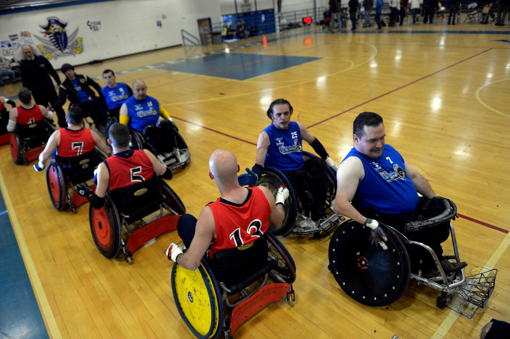. DENVER, CO. - FEBRUARY 10: The Denver Harlequins and the Northridge Knights shakes hands after their game during the Wheelchair Rugby Tournament February 10, 2013 at Englewood High School.  The Mile High Mayhem was put on by Craig Hospital and city of Englewood.(Photo By John Leyba/The Denver Post)