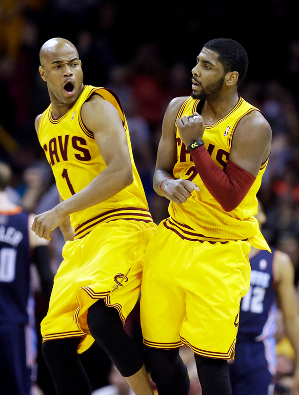 . Cleveland Cavaliers\' Jarrett Jack (1) and Kyrie Irving celebrate a shot in an NBA basketball game against the Charlotte Bobcats Saturday, April 5, 2014, in Cleveland. (AP Photo/Mark Duncan)