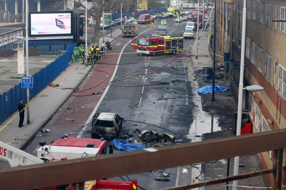 Description of . Emergency services at the scene after a helicopter reportedly collided with a crane attached to St Georges Wharf Tower in Vauxhall, on January 16, 2013 in London, England. According to reports, the helicopter hit the crane before plunging into the road below during the morning rush hour.  (Photo by Oli Scarff/Getty Images)