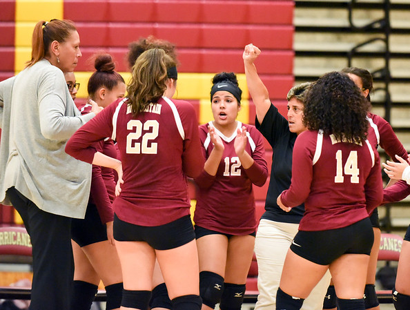 10/10/18 Wesley Bunnell | Staff New Britain volleyball vs Platt on Wednesday evening at New Britain High School. Head Coach Michelle Abraham raises her fist in the huddle during the match.
