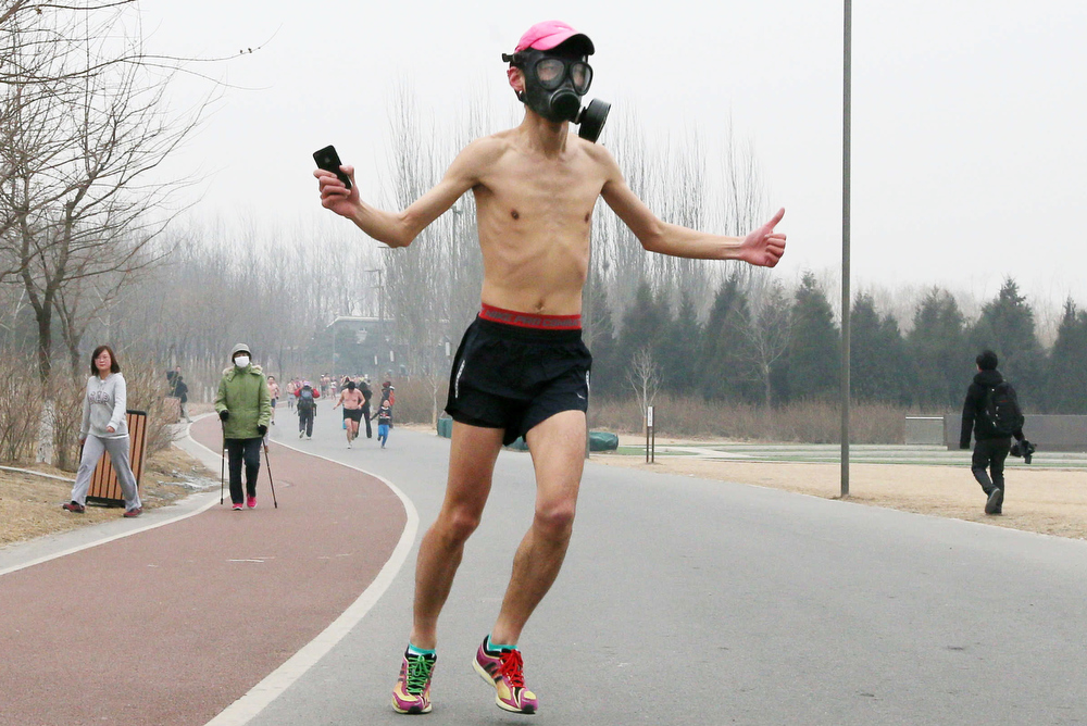 Description of . This picture taken on February 24, 2013 shows a man running with a gas mask during the annual 3.5 km Undie Run held in the Olympic Forest Park in Beijing. Some 300 participants wanted to prove that Chinese can brave the cold just as well as any nationality and promote nationwide fitness. There were no winners, no trophies and no starting gun or finishing line. AFP PHOTOAFP/AFP/Getty Images