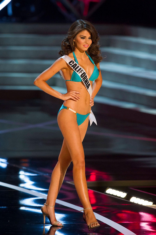 . Miss California USA 2013, Mabelynn Capeluj, competes in her ViX Paula Hermanny swimsuit and Chinese Laundry shoes during the 2013 MISS USA Competition Preliminary Show at PH Live in Las Vegas, Nevada June 12, 2013.  She will compete for the title of Miss USA 2013 and the coveted Miss USA Diamond Nexus Crown LIVE on NBC starting at 9:00 PM ET on June 16th, 2013 from PH Live.   Picture taken June 12, 2013.  REUTERS/Darren Decker/Miss Universe Organization L.P., LLLP/Handout via Reuters