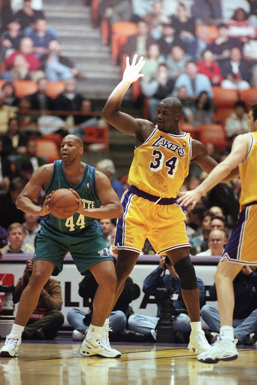 . Charlotte Hornets? Derrick Coleman, 44, looks to pass the ball as Los Angeles Lakers? Shaquille O?Neal, 34 and Travis Knight, right, defend on Tuesday, Feb. 16, 1999 at the Great Western Forum in Inglewood, California. (AP Photo/Kevin Karzin)