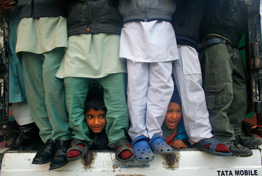 . Nepalese Muslim boys peek out from a vehicle as they participate in a rally to mark Milad-un-Nabi, the festival that commemorates the birthday of Prophet Muhammad in Katmandu, Nepal, Tuesday, Jan. 14, 2014. Muslims are a minority in this predominantly Hindu Himalayan nation. (AP Photo/Niranjan Shrestha)