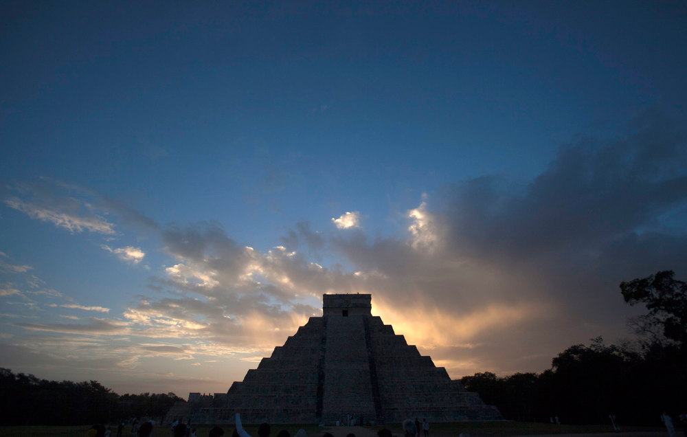 . The pyramid of Kukulcan is seen during sunrise at the archaeological zone of Chichen Itza in Yucatan State, Mexico, December 21, 2012. Mystics, hippies and tourists descended on the ruins of Maya cities to mark the close of the 13th bak\'tun - a period of around 400 years - and many hoped it would lead to a better era for humanity. REUTERS/Victor Ruiz Garcia