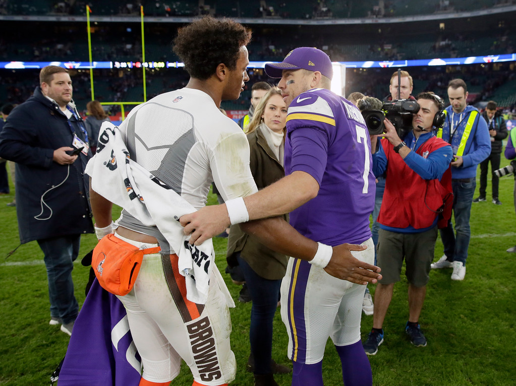 . Minnesota Vikings quarterback Case Keenum, right, talks with Cleveland Browns quarterback DeShone Kizer after an NFL football game at Twickenham Stadium in London, Sunday Oct. 29, 2017. The Vikings won 33-16. (AP Photo/Tim Ireland)