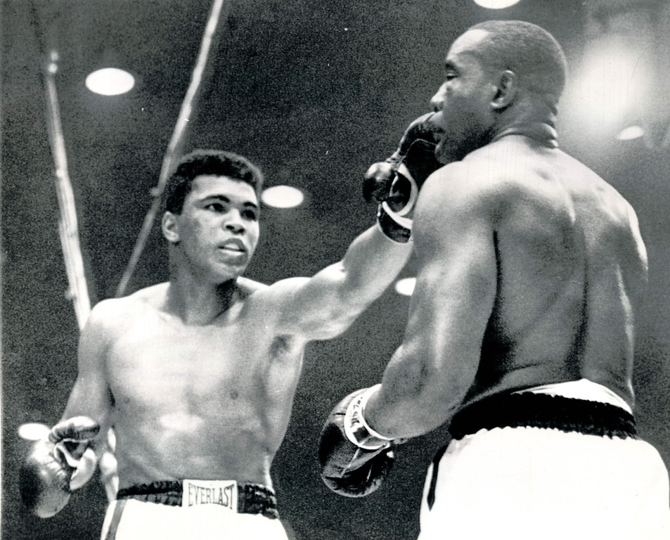 . MIAMI BEACH, Fla., Feb.25, 1964--HIT AND RUN--Challenger Cassius Clay pokes a fast left jab to the face of Sonny Liston during their championship heavyweight fight in Miami Beach, Fla.  Clay used the in and out tactics to gain a TKO in the seventh round after Liston strained a shoulder and suffered a bad gash under the left eye.    Credit: AP