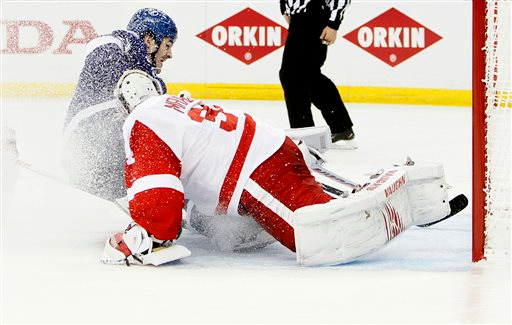 . Tampa Bay Lightning center Brian Boyle (11) beats Detroit Red Wings goalie Petr Mrazek (34) shorthanded to tie the score during the first period in Game 1 of an NHL hockey first-round playoff series, Thursday, April 16, 2015, in Tampa, Fla. (Diark Shadd/Tampa Bay Times via AP)