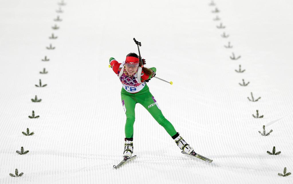 . Belarus\' Nadezhda Skardino skis on the finish straight to win bronze during the women\'s 15K individual biathlon race at the 2014 Winter Olympics, Friday, Feb. 14, 2014, in Krasnaya Polyana, Russia. (AP Photo/Matthias Schrader)