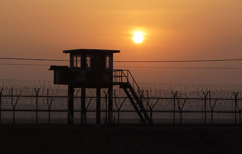 . The sun sets near a barbed-wire checkpoint near the border village of Panmunjom on April 4, 2013 in Paju, South Korea. Still 400 South Korean remain in the joint industrial park fearing they can not get back there once return to South. In recent weeks North Korea have threatened to attack South Korea and U.S. military bases, with South Korean and American intelligence identifying what is believed to be an intermediate-range missile being moved by North Korea to its eastern coast, in preparation for a planned strike.  (Photo by Chung Sung-Jun/Getty Images)