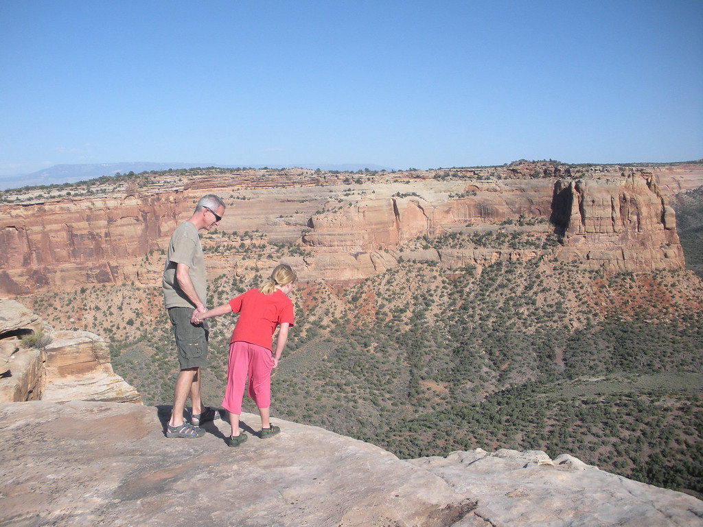 . Peering over the edge during a day hike in Colorado National Monument to see what\'s down there after a night of hiking in one of the family\'s favorite camping areas in the state.  Photo provided by Kara Williams