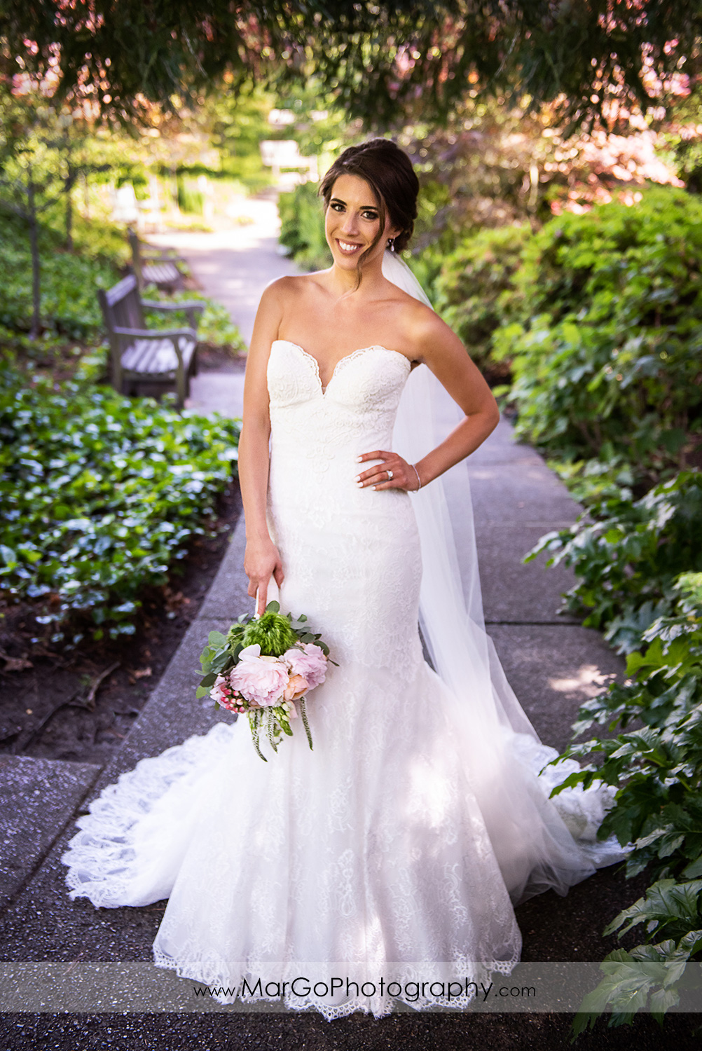 full body portrait of bride holding flowers at Piedmont Park