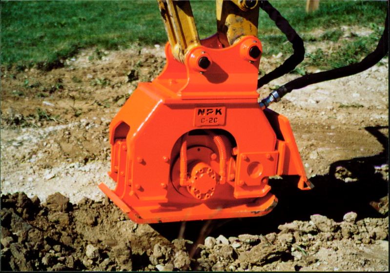 NPK C2C compactor with backfill blade on Cat mini excavator (10).JPG