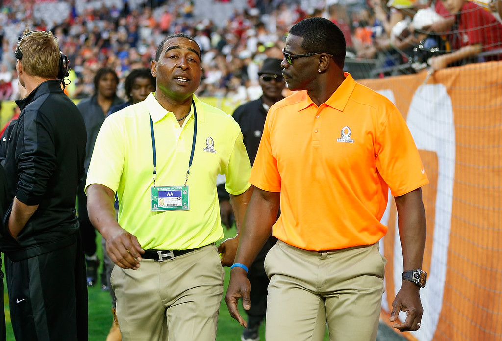 . GLENDALE, AZ - JANUARY 25: Pro Bowl alumni captains Cris Carter (left) and Michael Irvin (right) talk on the sidelines before the 2015 Pro Bowl at University of Phoenix Stadium on January 25, 2015 in Glendale, Arizona.  (Photo by Christian Petersen/Getty Images)